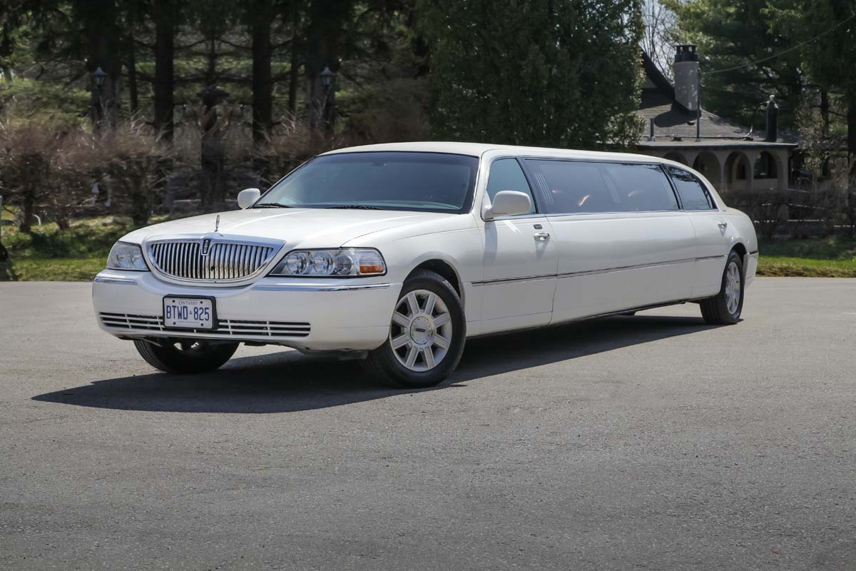 An image showing the exterior of the White Stretch Lincoln Town Car