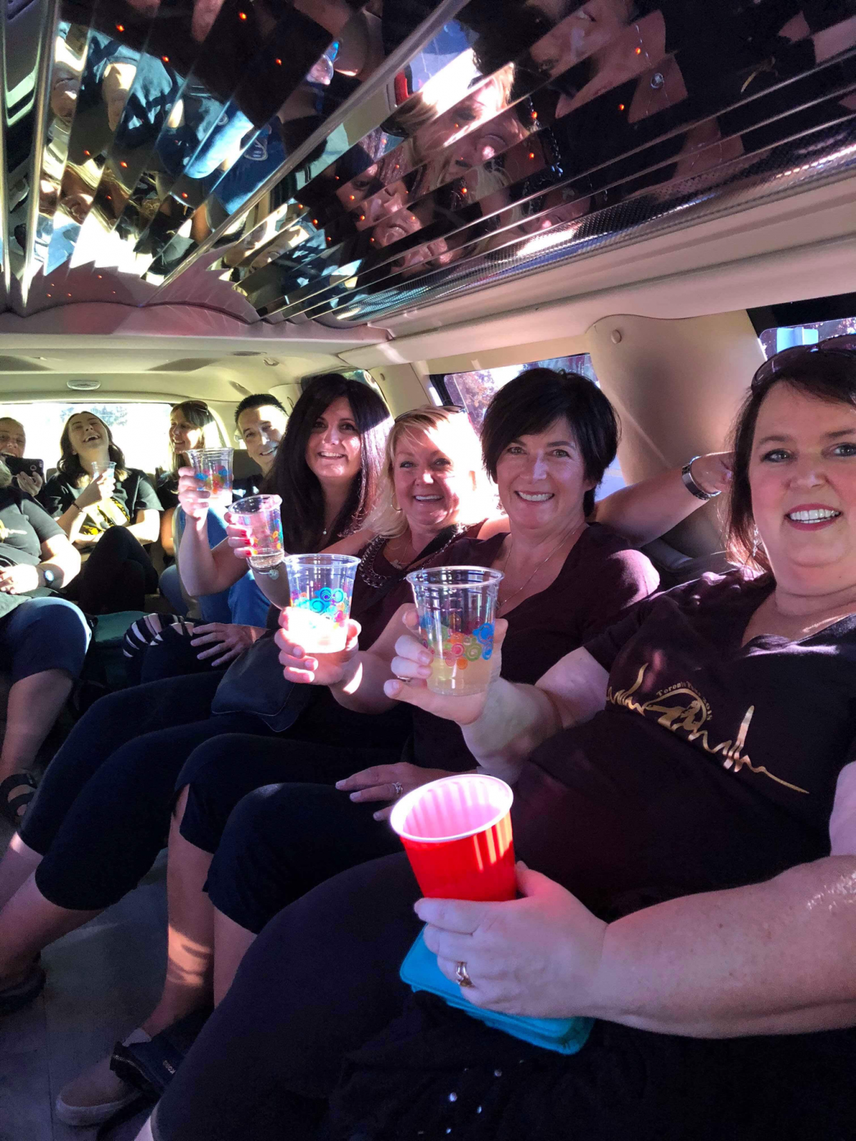 An image showing a number of women in the back of one of D&A's Limos
