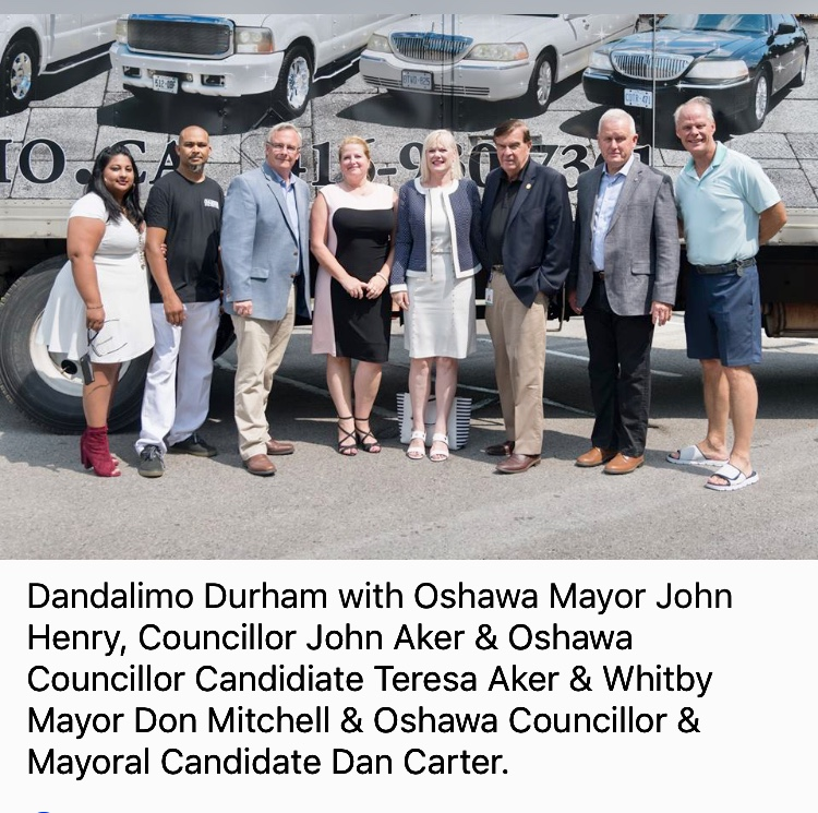 D and A Limo Durham team members standing in front of a Big Rig trailer with Mayor John Henry, Councillor John Aker, Councillor Candidate Teresa Aker, Mayor Don Mitchell and Councillor and Mayoral Candidate Dan Carter