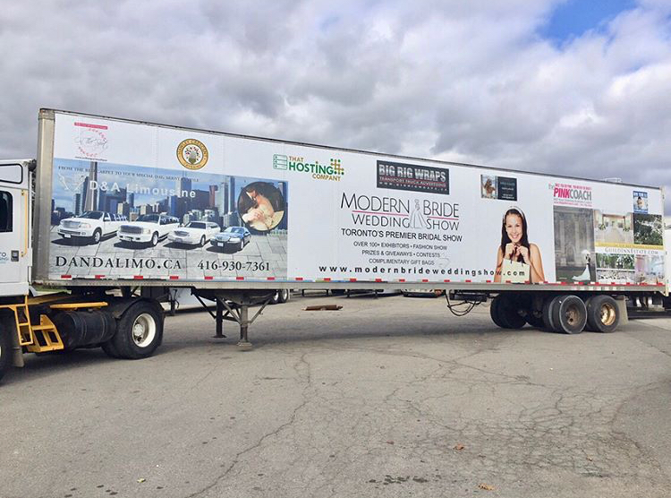 An image showing the D & A Limo advertising on the side of a transport truck trailer